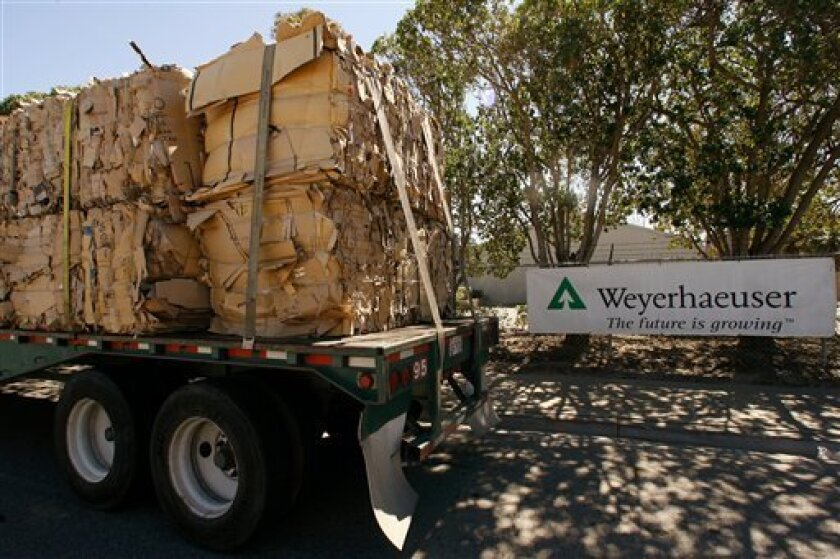 FILE - In this March 17, 2008 file photo, a truck loaded with recycled cardboard arrives at The Weyerhaeuser Co. Hueneme Paper Mill plant in Oxnard, Calif. Timber and forest products giant Weyerhaeuser Co., which has been hemorrhaging cash because of the moribund U.S. housing market, said Tuesday it is chopping its quarterly dividend again, this time by 80 percent. (AP Photo/Damian Dovarganes, File)