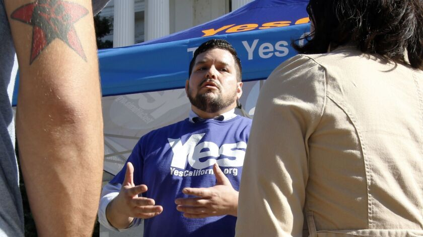 Marcus Ruiz Evans, center, of the Yes California Independence Campaign talks in Sacramento in 2017 about California seceding from the United States and becoming its own nation.