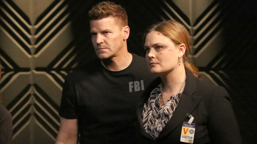 "David Boreanaz and Emily Deschanel appear in a scene from the Fox-produced television series ""Bones."""