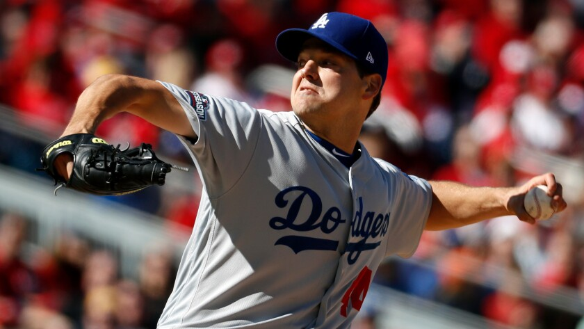 Dodgers' Rich Hill pitches against Washington on Oct. 9.