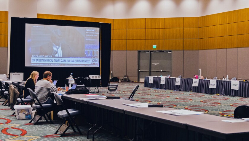 The incident command works in a large room within the San Diego Convention Center.