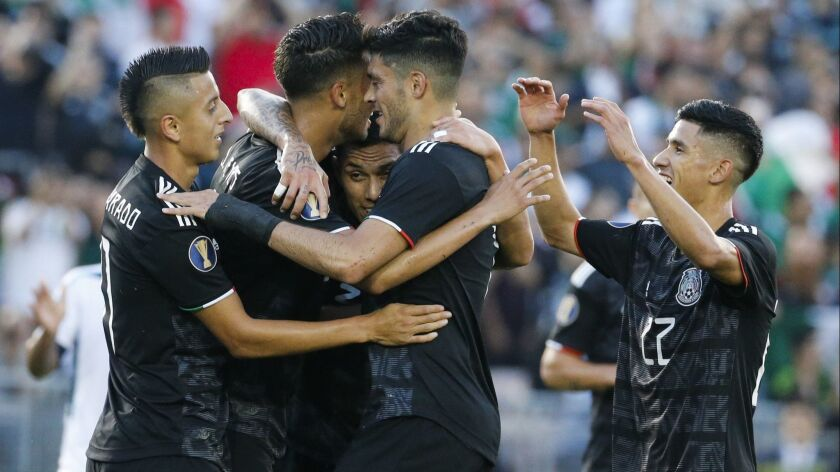 Mexico celebrate their goal during a CONCACAF Gold Cup soccer match between Mexico and Cuba in Pasad
