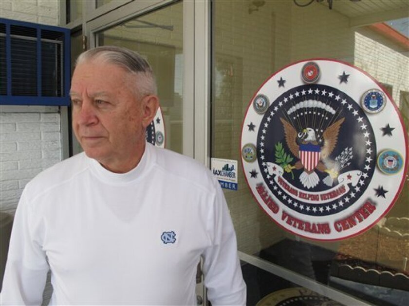 Len Loving, chief executive of the Allied Veterans Center, stands at the front door to the shelter for homeless veterans in Jacksonville, Fla., on Thursday, March 14, 2013. Loving says he may have to close the center by the end of June for lack of funding. The shelter gets almost all of its money f