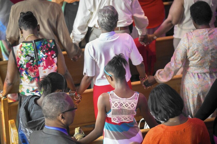 Worshipers at Olivet Institutional Baptist Church in Cleveland pray for healing on May 23, a day after Officer Michael Brelo was acquitted in the shooting death of two unarmed people at the end of car chase.
