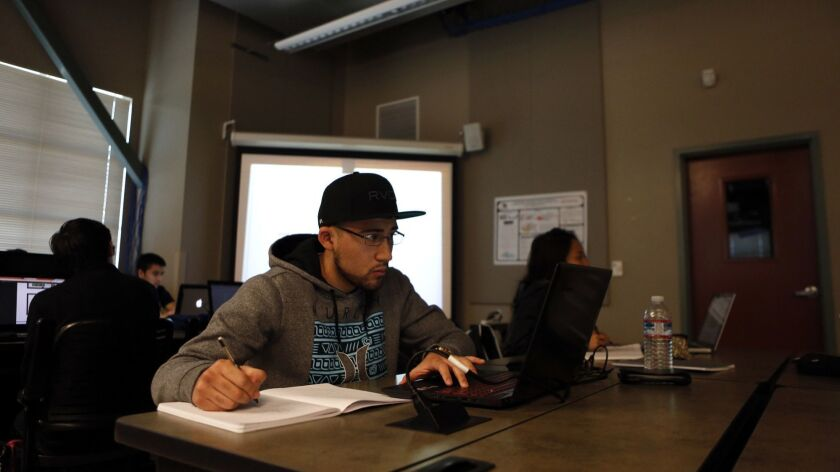 SALINAS, CA- FEBRUARY 3, 2016 - Dario Molina, 22, attends Computer Science 2A class at Hartnell Coll
