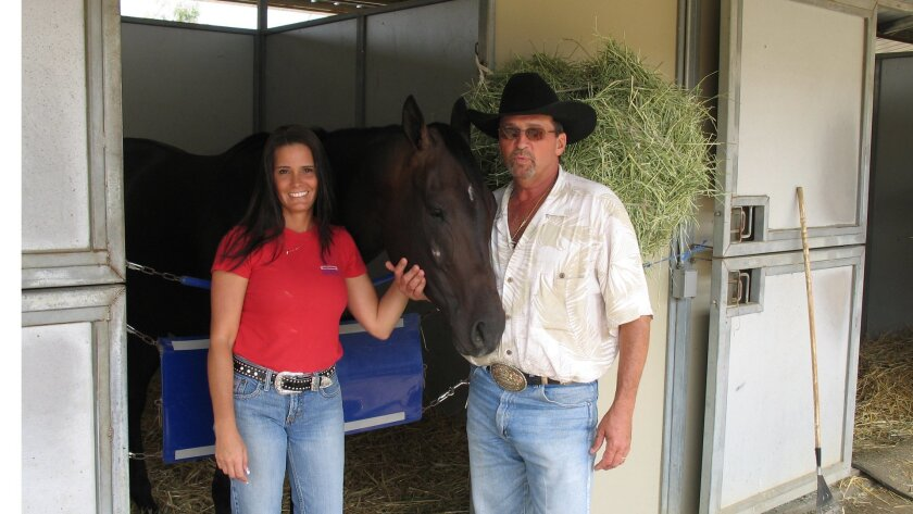 Donna and Dallas Keen of Keen Racing Stable in Texas tend to Bold And Fresh, a 3-year-old gelding who was bred on the Keen ranch.