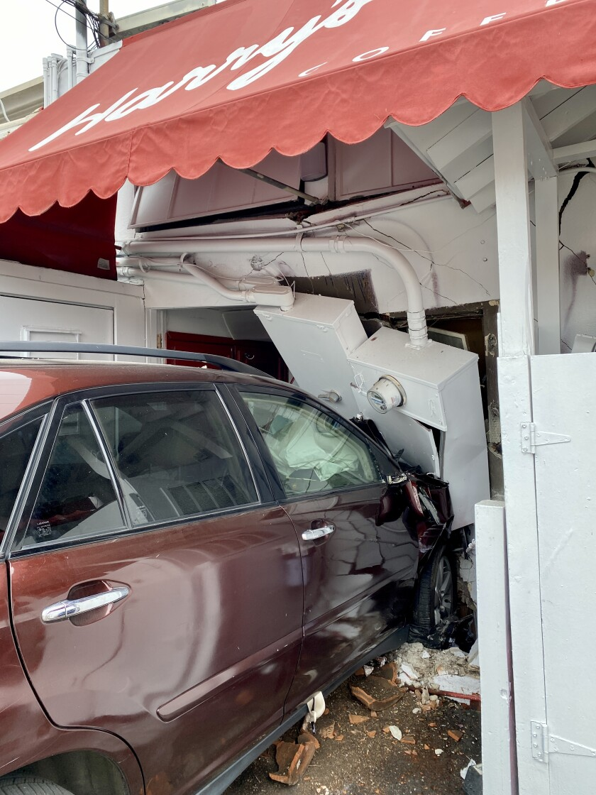 A car crashed into the rear of Harry's Coffee Shop on May 12, injuring three people.