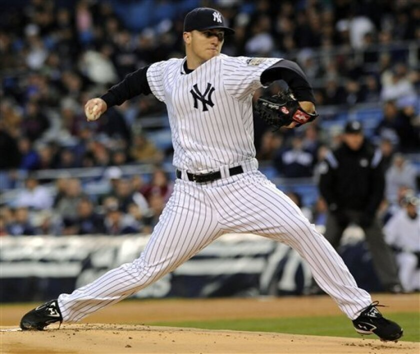 New York Yankees pitcher Phil Hughes delivers a pitch to a Toronto Blue Jays batter during first inning baseball action, Thursday, April 3, 2008 at Yankee Stadium in New York. (AP Photo/Bill Kostroun)