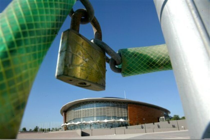 FILE - In this Aug. 8, 2005, file photo, a padlock hangs outside the Tae Kwon Do and Handball olympic stadium at the Faliro Coastal Zone, near Athens, Greece. While many factors are behind the crippling debt crisis in Greece, the 2004 Athens Olympics _ being the global event that it was _ has drawn
