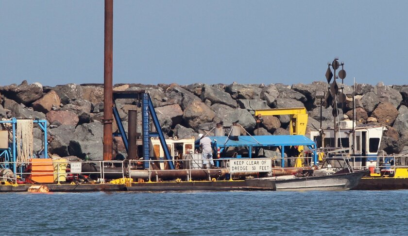 Dredging equipment on the north side of the mouth of the Oceanside Harbor in 2018.