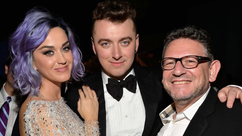 Katy Perry, left, Sam Smith and Universal Music Group's Chief Executive Lucian Grainge at a 2015 Grammys after-party.