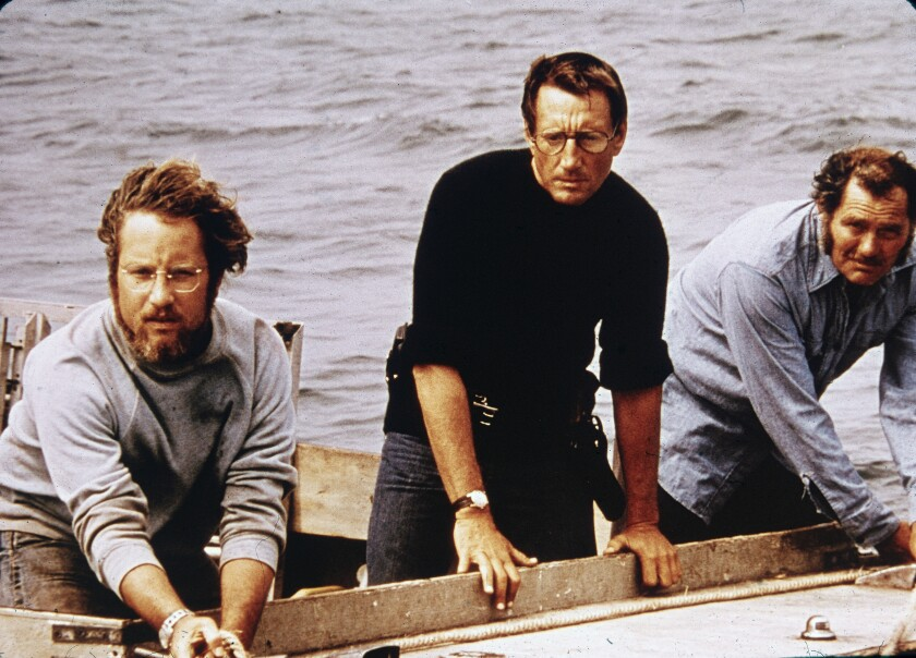 "Richard Dreyfuss (from left), Roy Scheider and Robert Shaw on board a boat in a still from the film ""Jaws,"" directed by Steven Spielberg."