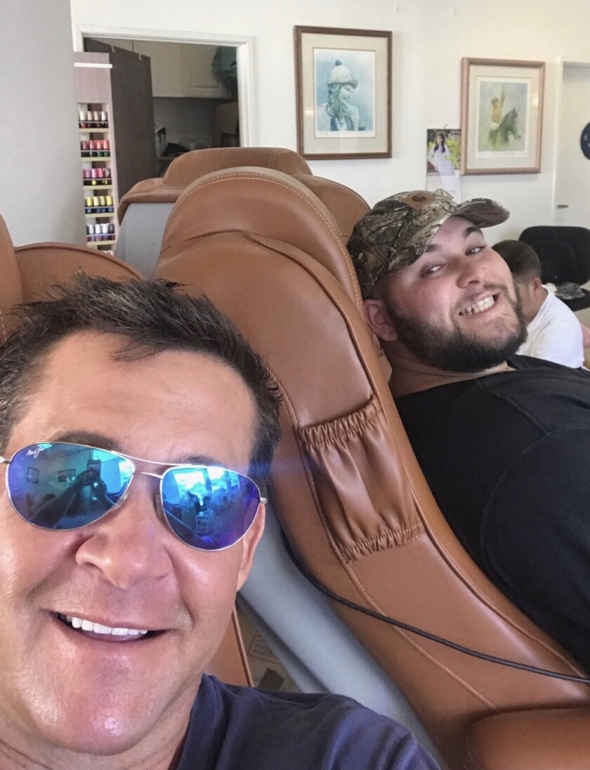 Jake Palet, right, looked up to family friend Bret Boone, a longtime big-leaguer and All-Star. Here, the two share a laugh while getting pedicures.