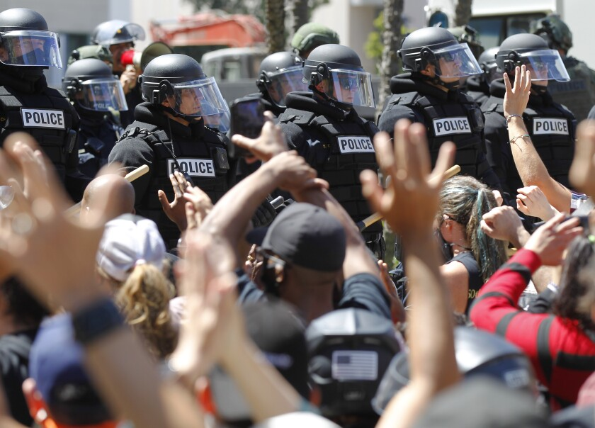 San Diego police in riot gear face protesters
