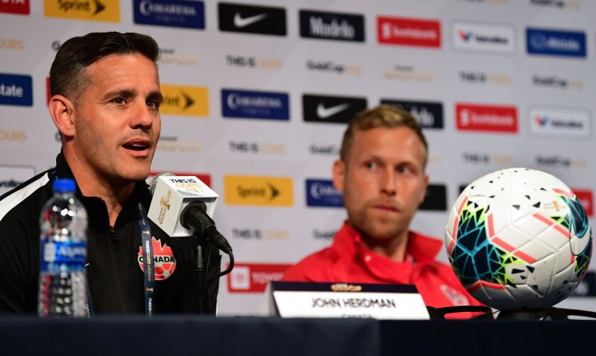 Canada coach John Herdman responds to questions during a CONCACAF Gold Cup news conference June 14.