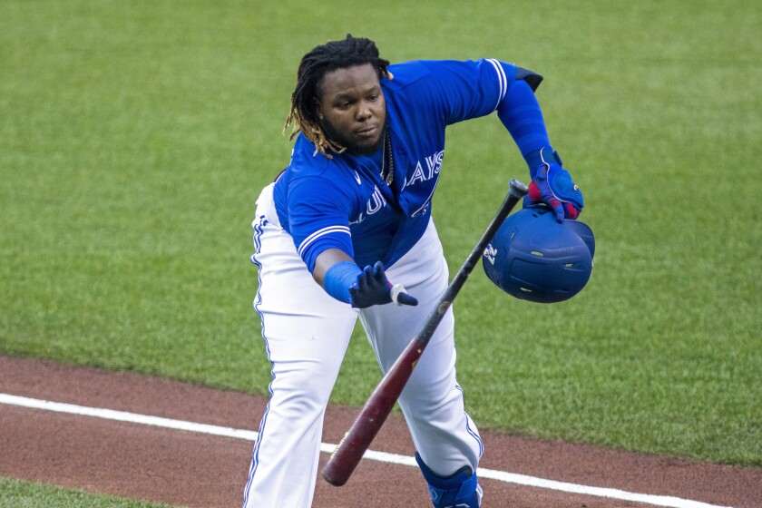 Toronto Blue Jays' Vladimir Guerrero Jr. catches his bat which was thrown to him during the baseball team's intrasquad game in Toronto on Thursday, July 9, 2020. (Carlos Osorio/The Canadian Press via AP)