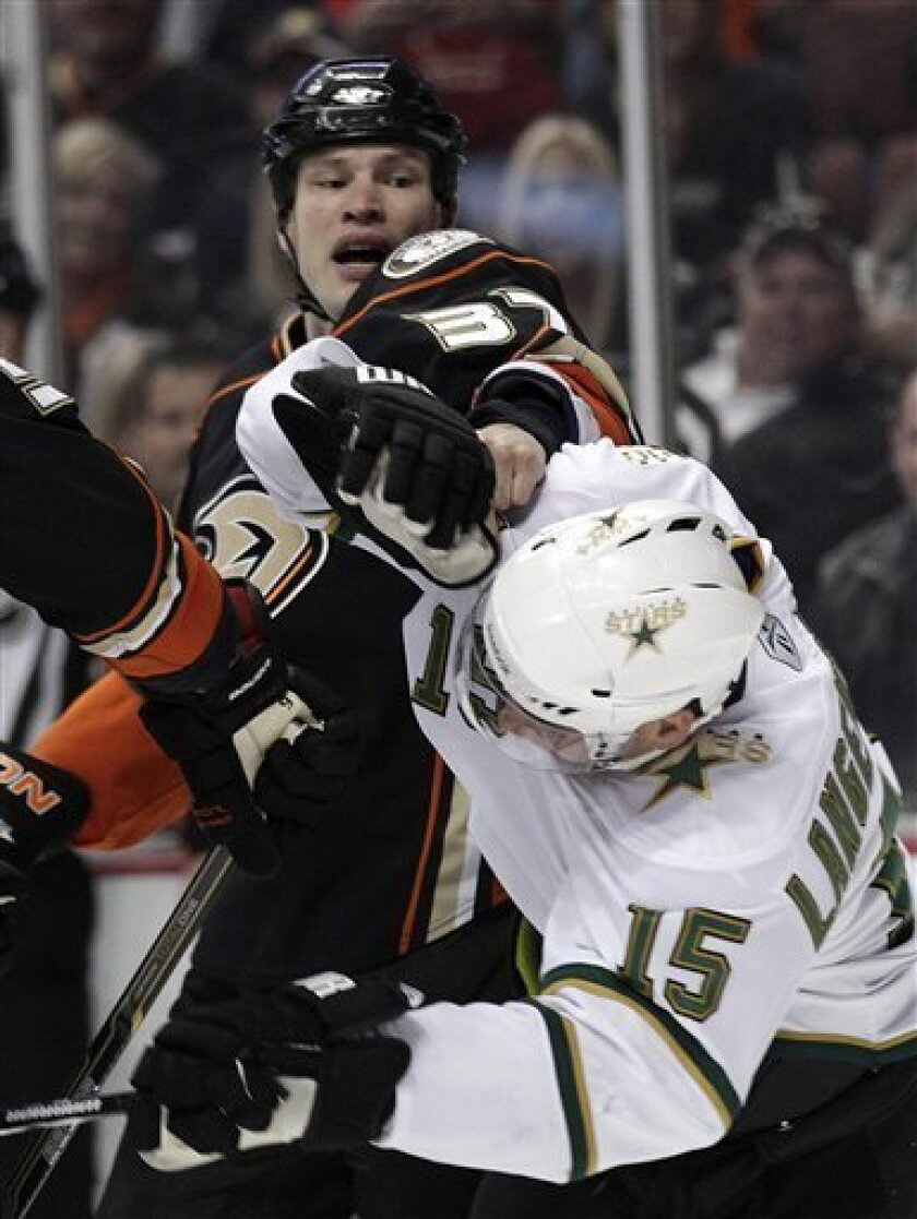 Anaheim Ducks left wing Jarkko Ruutu punches Dallas Stars right wing Jamie Langenbrunner (15) during the first period of an NHL hockey game in Anaheim, Calif., Friday, March 4, 2011. (AP Photo/Jae C. Hong)