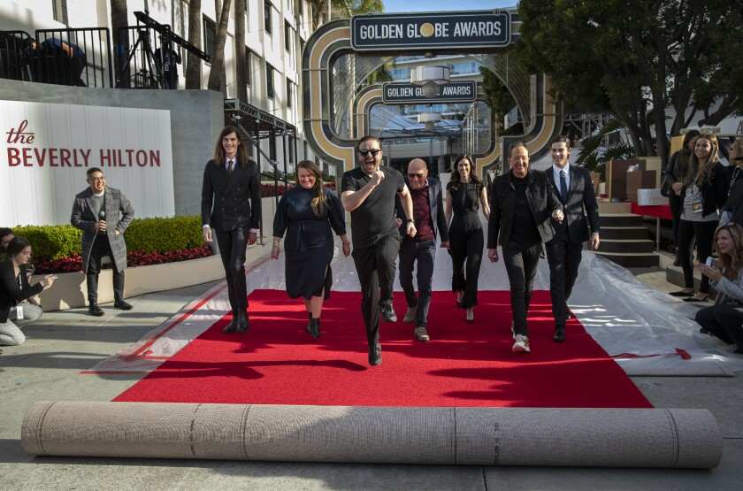 2019 Golden Globes host Ricky Gervais rolls out the red carpet in front of the Beverly Hilton Hotel.