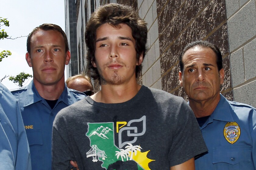 """FILE- In this May 30, 2013 file photo, Caleb """"Kai"""" McGillvary, 24, center, is taken by Union County sheriff's officers to jail in Elizabeth, N.J. The former online celebrity who became known for allegedly using a hatchet to fend off an attack on a highway worker, failed in his attempt to have his conviction in a 2013 murder overturned, Thursday, Aug. 5, 2021. (AP Photo/Mel Evans, File)"""