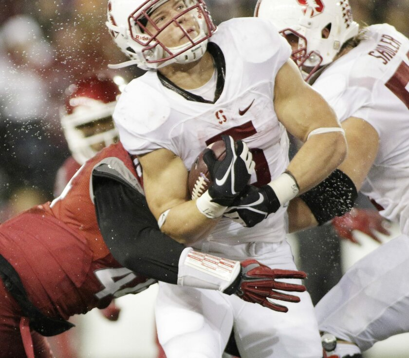 Washington State linebacker Chandler Leniu, left, brings down Stanford running back Christian McCaffrey (5) during the first half of an NCAA college football game, Saturday, Oct. 31, 2015, in Pullman, Wash. (AP Photo/Young Kwak)