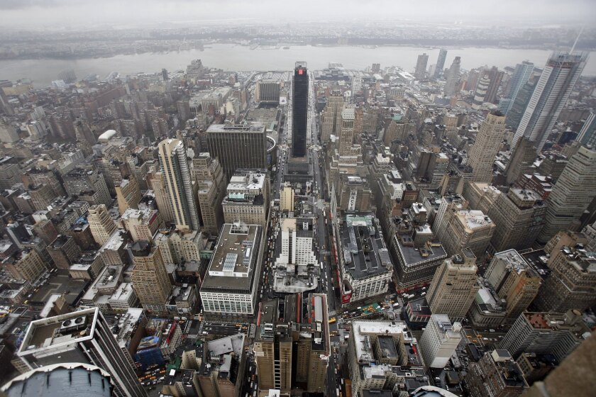 New York has the highest portion of millionaires of any U.S. city, according to a study. Shown here, a view of Manhattan seen by looking west from the observation deck at the Empire State Building.