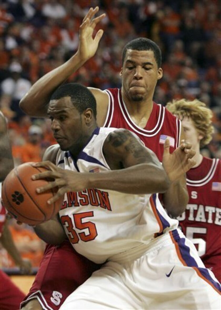 Clemson's Trevor Booker (35) drives past North Carolina State's Brandon Costner (33) tries to block the shot during the first half of an NCAA college basketball game Saturday, Jan. 10, 2009, at Littlejohn Coliseum in Clemson, S.C. (AP Photo/Mary Ann Chastain)