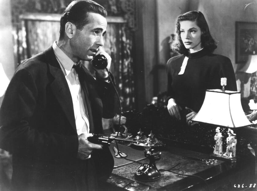 """CA.Sleep.0613.ls.$. Humphrey Bogart and Lauren Bacall star in the 1946 movie, """"The Big Sleep ."""""""
