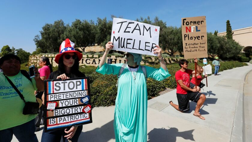 Friends Rickey Goodling, left, and Beth Mcnamara protest at the entrance to Pelican Hill on Monday,