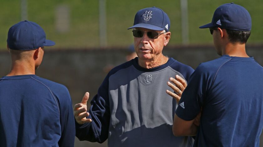 Coach Mike Gillespie, center, talks with assistants Ben Orloff, left, and Eric Deragisch during a UC Irvine practice in 2014.