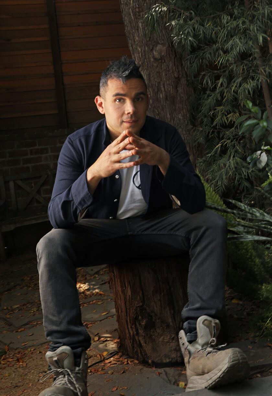 Rostam sitting in his backyard in L.A.