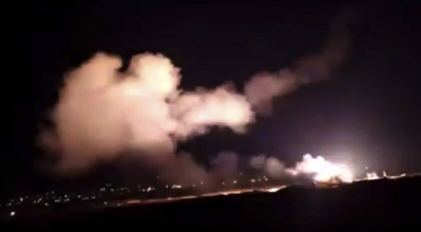 A scene from a video of missiles flying into the sky near Damascus, Syria.