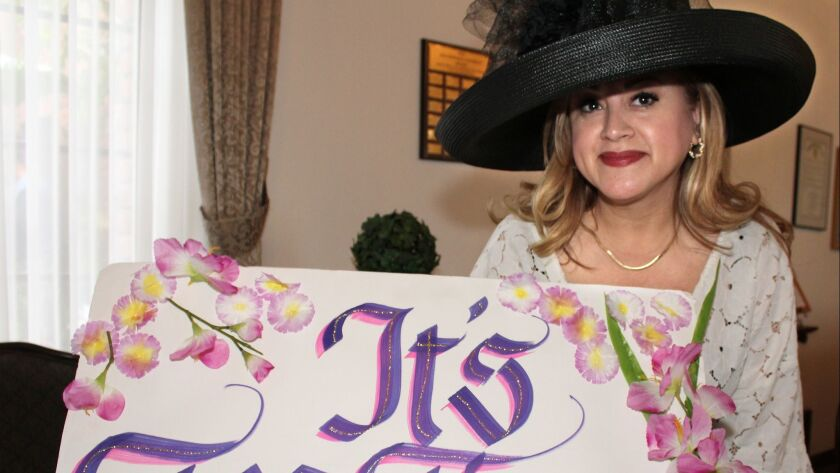 """Glendale Assistance League member and winner of """"Most Beautiful Hat,"""" Judy Rezvani welcomes all to t"""