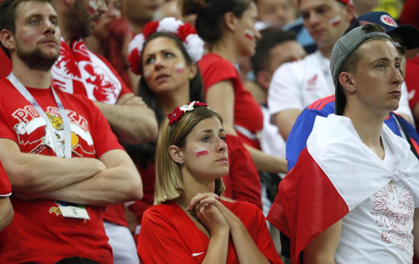 Supporters of Poland react after the FIFA World Cup 2018 group H preliminary round soccer match between Poland and Colombia in Kazan, Russia, 24 June 2018. Poland lost the match 0-3.