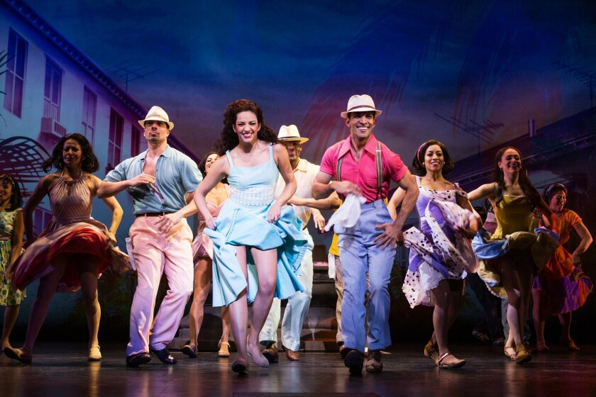 """This image released by Vivacity Media Group shows Ana Villafane, center, as Gloria Estefan in the musical """"On Your Feet!"""" (Matthew Murphy/Vivacity Media Group via AP)"""