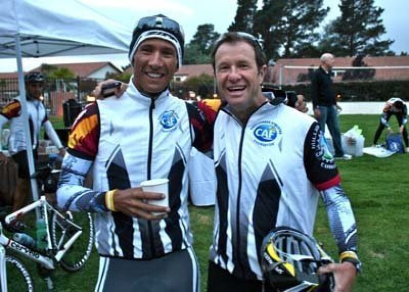 This weeke's Challenged Athletes Foundation events include the Million Dollar Challenge, which 2010 Ironman Champion Chris McCormack and La Jollan Jeffrey Essakow, Challenged Athletes Foundation's co-founder and president of the board of directors, are riding in. Here, they pause before departing from Santa Cruz on day two of their 640-mile journey from San Fransisco to La Jolla Shores' Kellogg Park. They are part of the group riding in the CAF Million Challenge, which wraps up in La Jolla Friday afternoon. Photo: Patrice Malloy