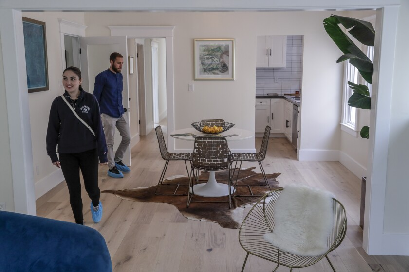 Potential buyers look through an open house last month in Los Angeles.