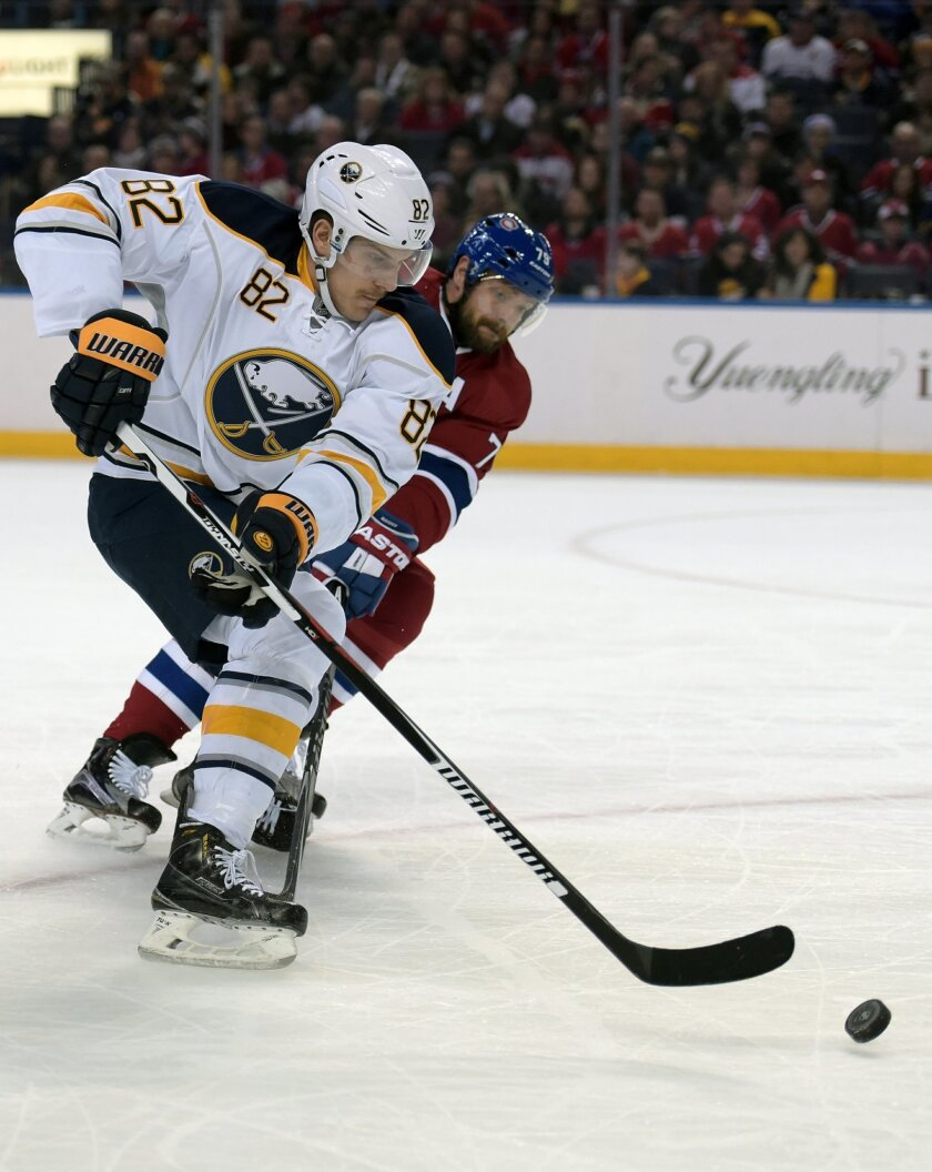 Buffalo Sabres' Marcus Foligno (82) moves around Montreal Canadiens' Andrei Markov, right, during the first period of an NHL hockey game, Friday, Feb. 12, 2016, in Buffalo, N.Y. (AP Photo/Gary Wiepert)