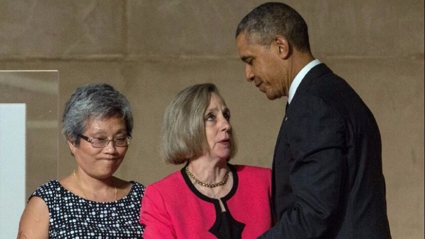 President Barack Obama introduces survivor Ling Young and Alison Crowther, mother of victim Welles Crowther, during the National September 11 Memorial & Museum dedication ceremony in New York on May 15, 2014.