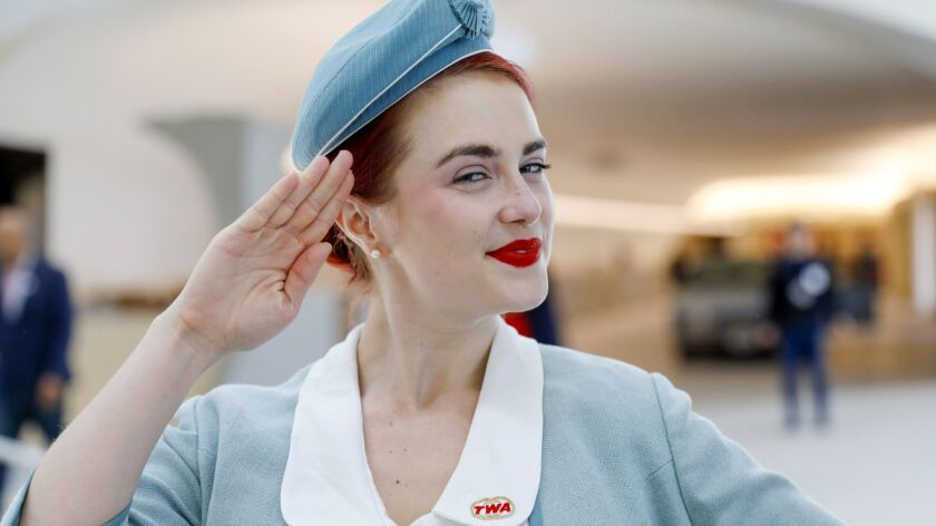 Pearls Daily wears a vintage TWA stewardess uniform while greeting visitors to the TWA Hotel at New