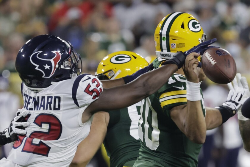 Houston Texans' Jonathan Greenard causes a fumble by Green Bay Packers' Jordan Love during the first half of a preseason NFL football game Saturday, Aug. 14, 2021, in Green Bay, Wis. (AP Photo/Mike Roemer)