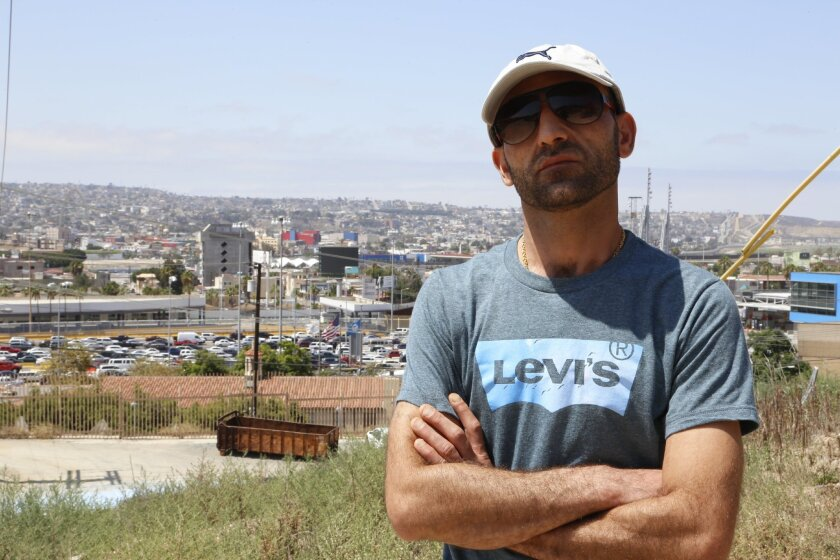 """Fadi Hirmiz near the San Ysidro border crossing. At home in Iraq, """"I was afraid for my family, for our kids."""""""