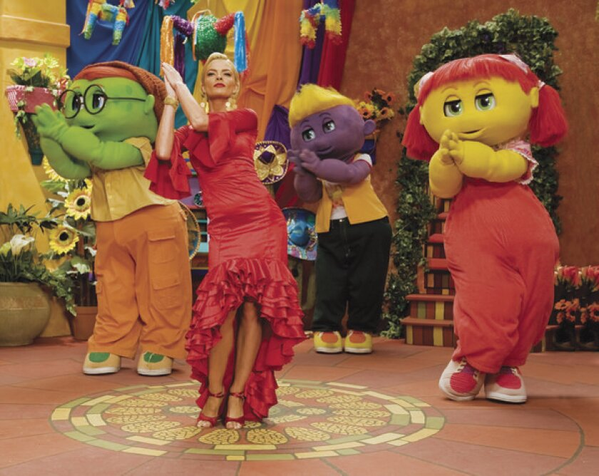 """Jaime Pressly dances with the Oogieloves from the movie """"Oogieloves and the Big Balloon Adventure."""""""