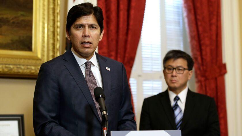 Senate President Pro tem Kevin de Leon, D-Los Angeles, accompanied by state Treasurer John Chiang, r