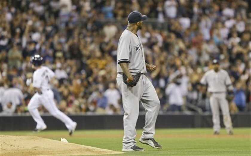 New York Yankees starting pitcher CC Sabathia wanders behind the mound as San Diego Padres' Logan Forsythe rounds the bases with a home run in the fourth inning of a baseball game in San Diego, Friday, Aug. 2, 2013. (AP Photo/Lenny Ignelzi)