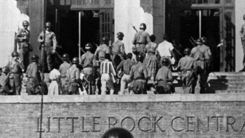 Federal troops escort nine black students into formerly all-white Central High School in Little Rock, Ark., on Sept. 25, 1957, enforcing the 1954 Supreme Court ruling that outlawed racial segregation in public schools.