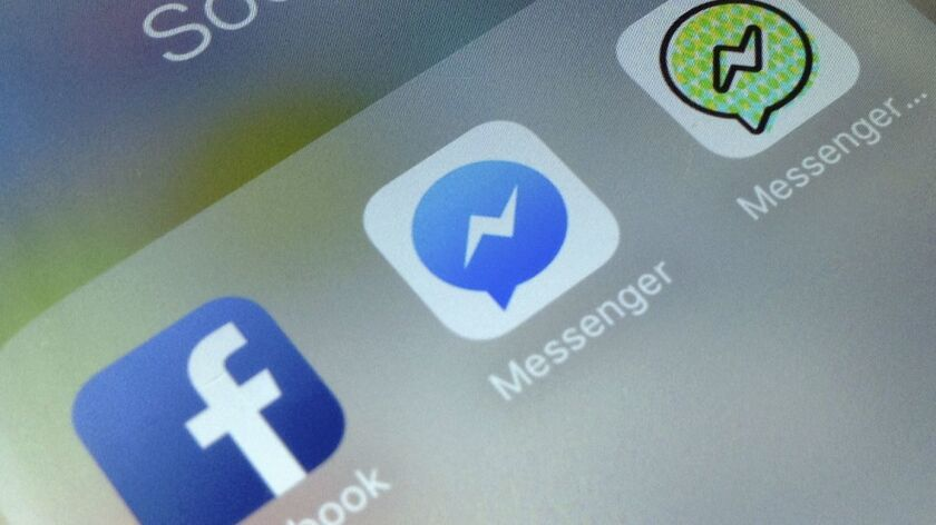 This photo shows application icons from left, Facebook, Facebook Messenger and Messenger Kids on an