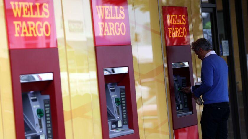 A customer uses a Wells Fargo ATM in San Francisco.