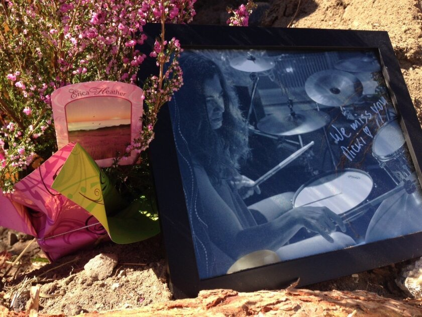 A makeshift memorial commemorates Nicki Carano, a musician who was killed when a massive tree fell onto her car in Pacific Beach.