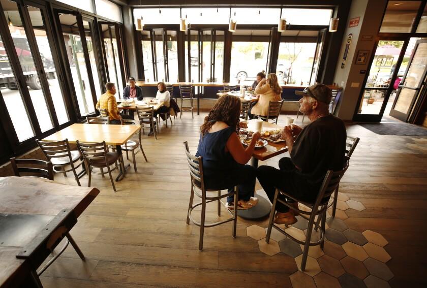 People dine inside a restaurant.