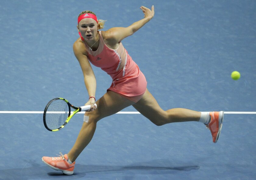 Caroline Wozniacki of Denmark returns the ball to Dominika Cibulkova of Slovakia during the St. Petersburg Ladies Trophy-2016 tennis tournament match in St.Petersburg, Russia, Thursday, Feb. 11, 2016. (AP Photo/Dmitri Lovetsky)